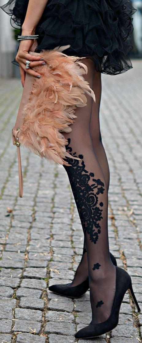 Street style lace tights and feathers handbag