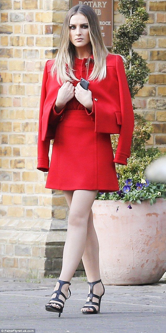 Scarlet stunner: Perrie, 22, flaunted her slender pins in a chic red mini-skirt, teamed with a matching red blouse and co-ord jacket caped over her shoulders