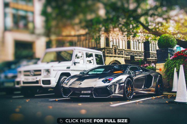 Black Lamborghini Next to Jeep