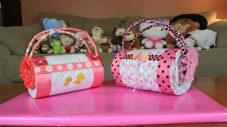 Another quick and easy Diaper Cake idea by Thom, a Diaper Cake Purse. This is one of the easier Diaper Cakes to make and does not need a lot of items to make...