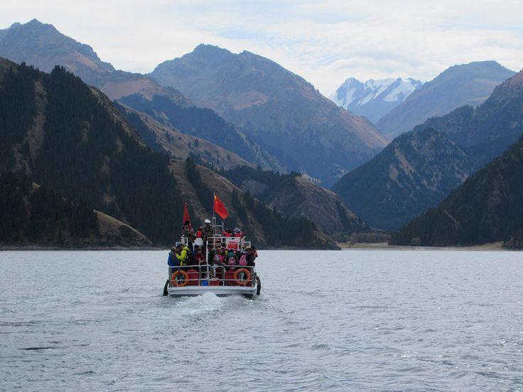 The Bogda mountain range is visible across Tianchi Heavenly Lake east of Urumqi, Xinjiang, China.