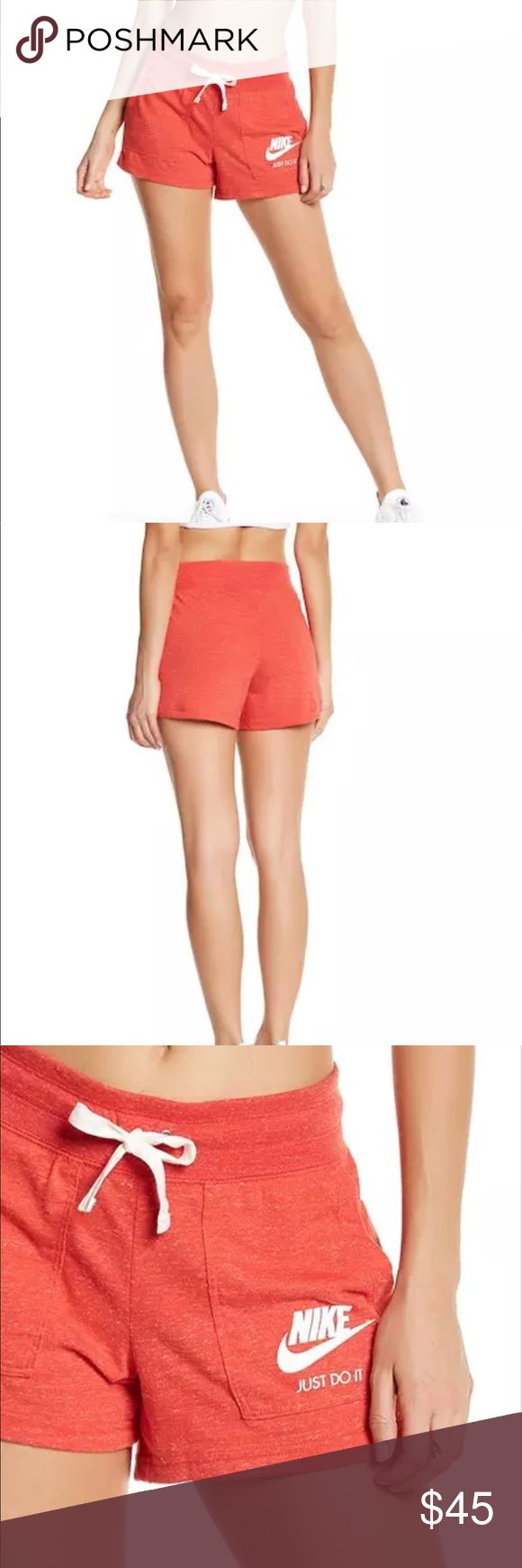 "Nike Women's Orange Gym Cotton Blend Short * Nike Women's Orange Gym Cotton Blend Short Size XS * New with tag * Purple * Elasticized waist with drawstring * 2 front patch pockets * Marl knit construction * Brand logo detail  * Size S - Approximately 14"" waist(side to side) and Total Length 12"" Nike Shorts"