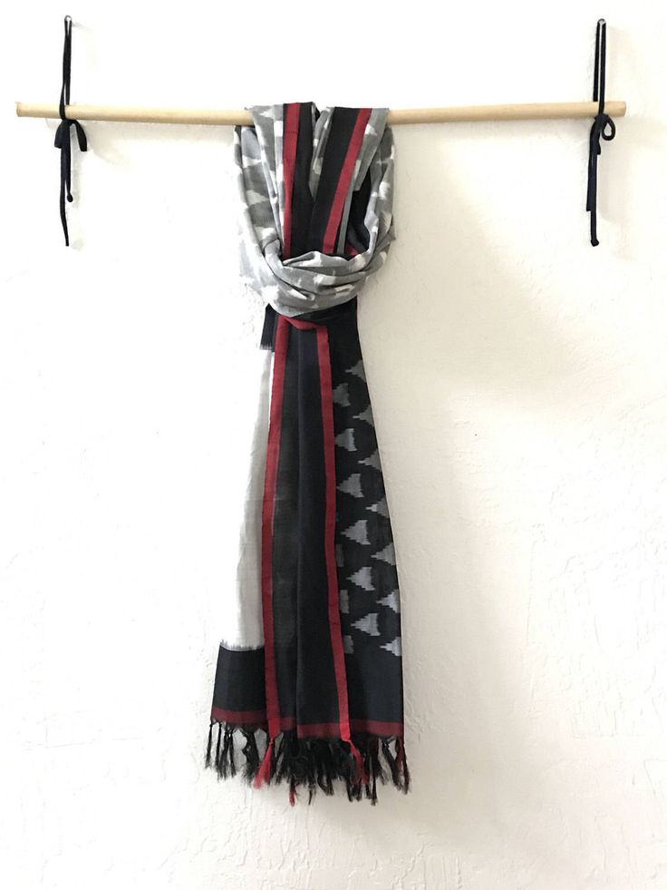 A personal favorite from my Etsy shop https://www.etsy.com/listing/516926467/black-and-white-ikat-scarf-black-scarf