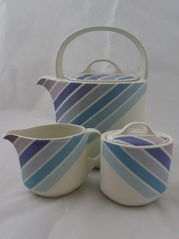 Beautifully shaped retro coffee / teapot with a narrow spout and lovely handle, featuring diagonal stripes in blue and purple shades on a white background. Marked microwave and dishwasher safe Great Midwinter collectible Vintage condition - shows signs of wear: no chips / cracks