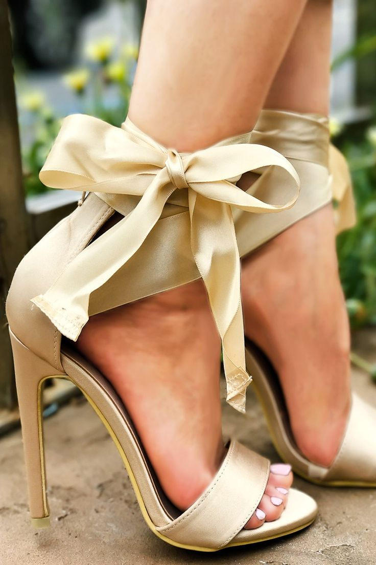 These high heels shoes feature a satin material, open toe, elegant bow tie look, a stiletto high heels shoes measures about 4 inches