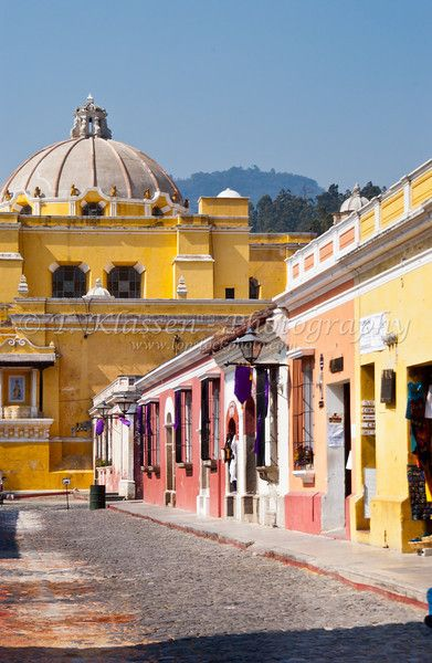 The dome of the monastery and 5th Ave. shops in Antigua, Guatemala, Central America.