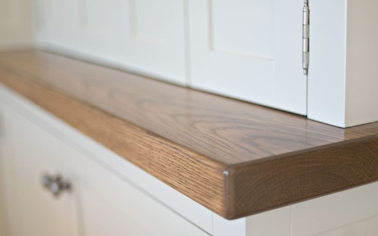 A solid timber bench top is a beautiful feature of this concealed work space.