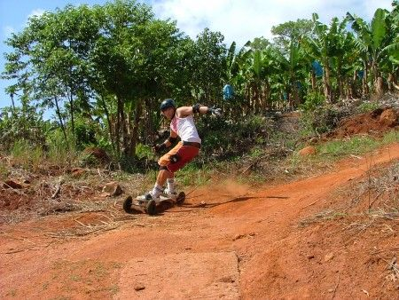 Mountain Boarding South Africa - Mountain Boarding with Induna Adventures in the Mpumalanga area. Join us for a rush of beautiful forestry roads down into the Sabie Valley! Mountain boarding is quite easy for anyone with generally good balance. Enjoy the views and tranquillity of the forest.