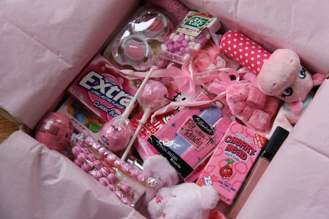 Sometimes Creative: Pink Care Package. This is for a baby girl, but I like the idea of picking a color theme for the care package. Fun!