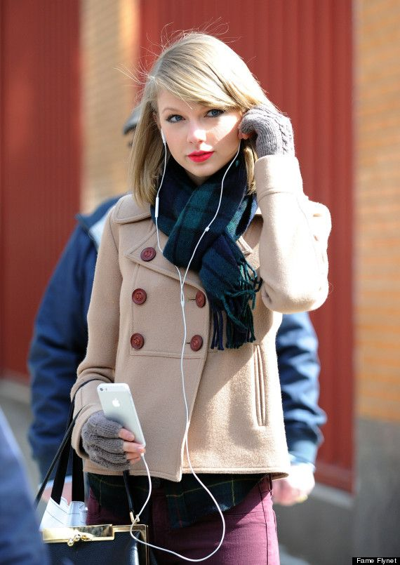 Kinda loving Taylor Swift's new look with the shoulder length hair and long, side-parted bangs. Nice jacket, too. See article for rest of outfit.