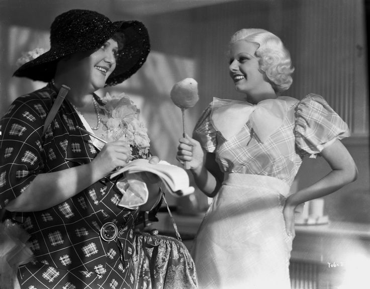 Jean Harlow Scene from a Film standing in Tartan Short Sleeve Linen Dress with Right Hand Holding a Big Spoon Premium Art Print