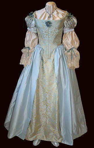 "Absolutely stunning 1660s Restoration gown made of blue and gold silk brocade, blue silk cartridge-pleated overskirt, silk taffeta ribbon and vintage lace adornments, and champagne silk ""shift"" undersleeves with slashed and piped oversleeves. Exquisite!"