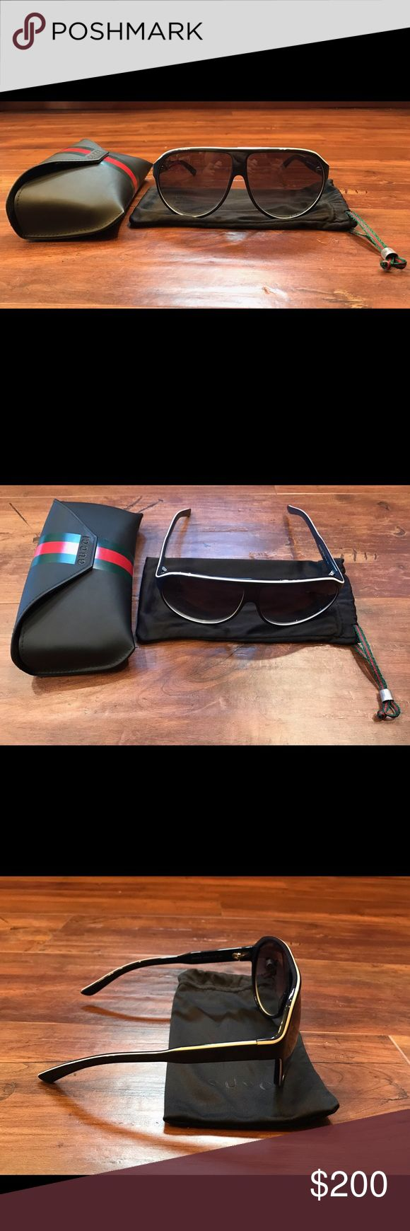 Gucci Sunglasses Men's style Gucci shield sunglasses in excellent condition.  Women can wear this style too!  Authentic/purchased in Bloomingdale's in NYC.  Navy blue plastic frames.  Case & dust bag included. (style no. gg 1628/s) Gucci Accessories Sunglasses