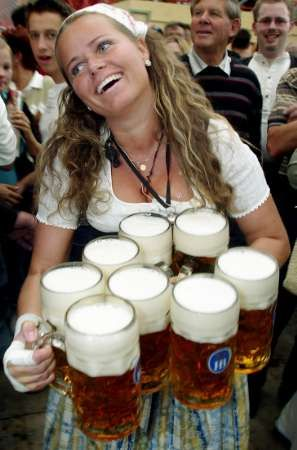 Oktoberfest, Munich, Germany -looks like there's an 'extra' two pitchers in this gal's grasp!