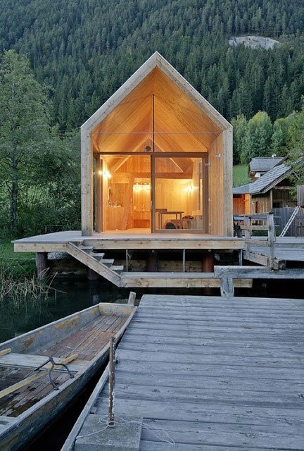 Beautiful, minimalistic bathhouse made completely out of larch at the Weissensee lake, Austria / designed by Architect Peter Jungmann and photographed by Wolfgang Rescuers