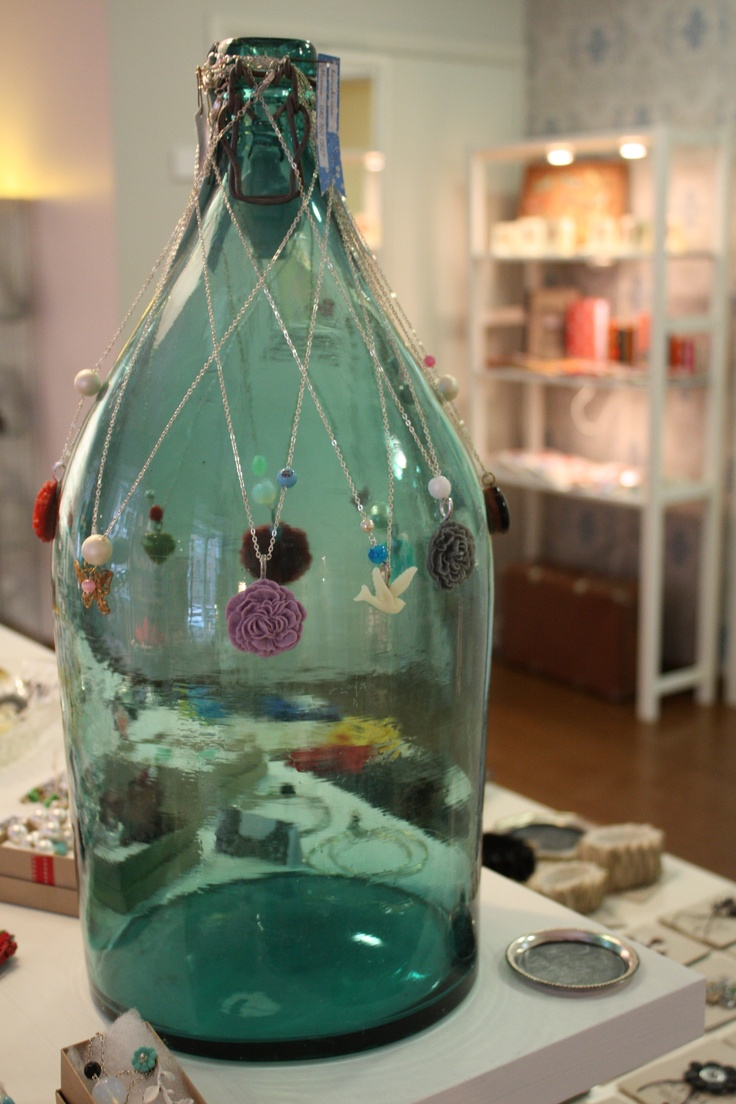 Karuski jewelry on a vintage bottle