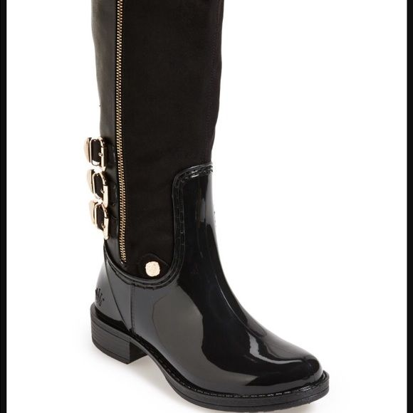 """NWOB Posh Wellies Brealyn Black Rain Boots Size 6 A season's favorite rain boot with on-trend equestrian styling is embellished with a trio of decorative buckles and an exposed antique gold zip. The waterproof foot and a wearable stacked heel make this stunning Posh Wellies boot as fashion-forward as it is practical. 1 1/4"""" heel. 16"""" boot shaft; 16"""" calf circumference. Faux side-zip closure. Textile and synthetic upper and lining/rubber sole. Posh Wellies  Shoes Winter & Rain Boots"""