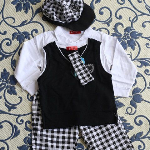 A playful suit, suitable for photos, special occasions or dress up. Easy to wear and comfortable with no zips or uncomfortable seams or hems. The boys don't even notice they are wearing something more dressy than jeans and a shirt! The pants even have little pockets which any parent of a boy knows are essential for collecting stones and twigs and bottle caps.