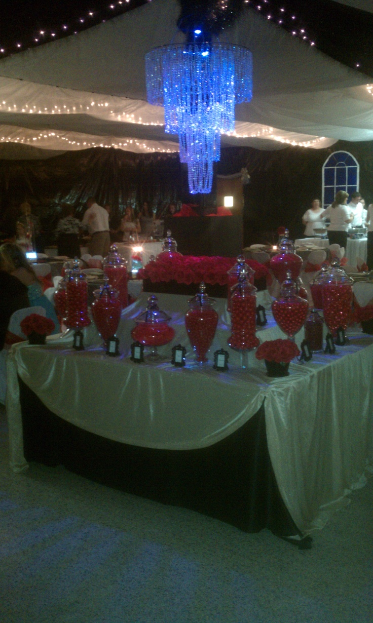 A red, gold, and black candy buffet for a Titanic themed prom. By Fugini's Candy Buffets & Wedding Services