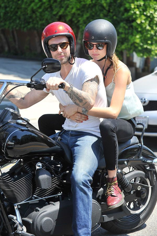 Adam Levine & Behati Prinsloo — I hope she flys off the back.  Think her stupid hat is under the helmet?