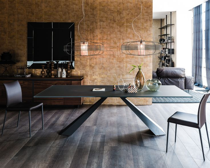 The Edward dining table is available in 4 sizes with a 12mm thick extra clear frosted graphite painted glass top and base in a choice of white or graphite lacquered steel or stainless steel.  (The top on the 240 dining table is 15mm thick).