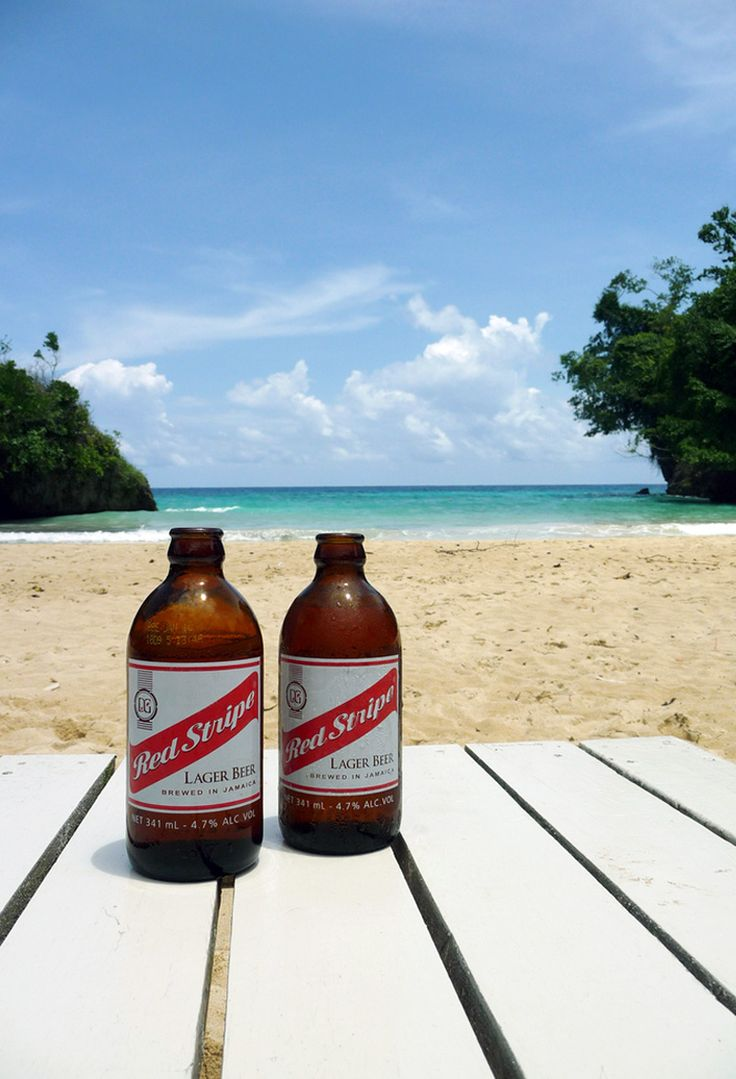 The Jamaican Famous Red Stripe Beer, a beautiful beach and an amazing ocean..... now, that's a vacation! #JamaicaMiHappy @MyJamauca