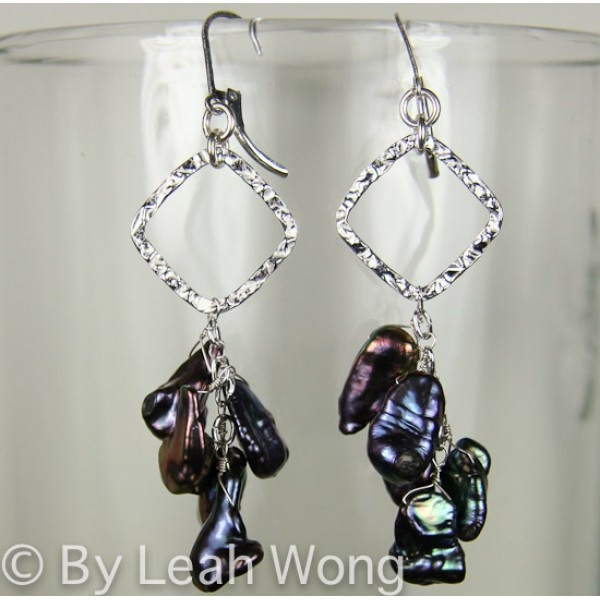 Each of the earrings have five pearls wire wrapped and dangle like a waterfall for a square shaped sterling silver piece at the top. The color and luster on these pearls is exquisite. You will love these earrings! $45.00