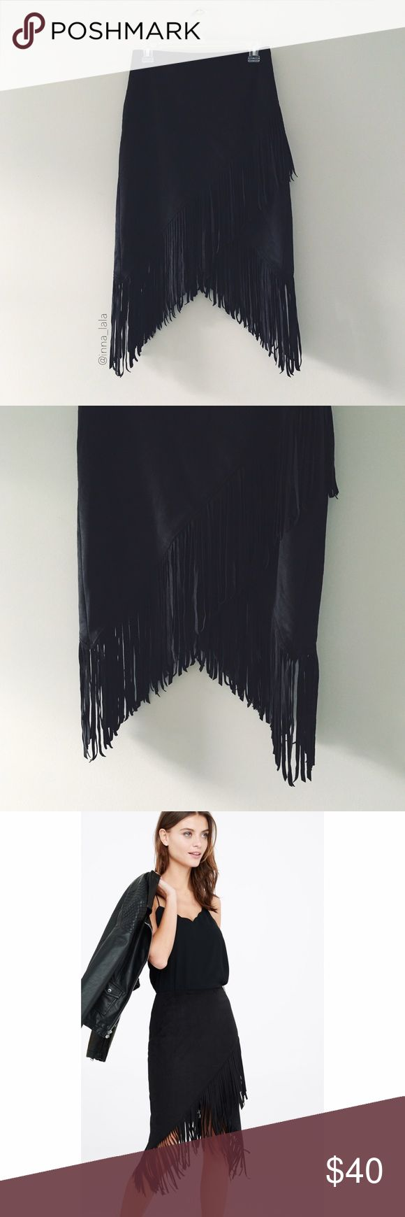 "Express Faux Suede Fringe Skirt Express Faux Suede Fringe Skirt A supple, faux suede wrap skirt with ample, eight-inch fringe that swishes when you walk. Keep it simple and sexy with a shape-skimming ribbed sweater or go for a fully Southwestern vibe with a cami and denim jacket. -High waisted -Hidden hook and zipper on side -8"" fringe embellishment -Wrap hem; Lined -Polyester/Spandex body; Polyester lining -Machine wash : inna_lala & express.com Express Skirts Midi"