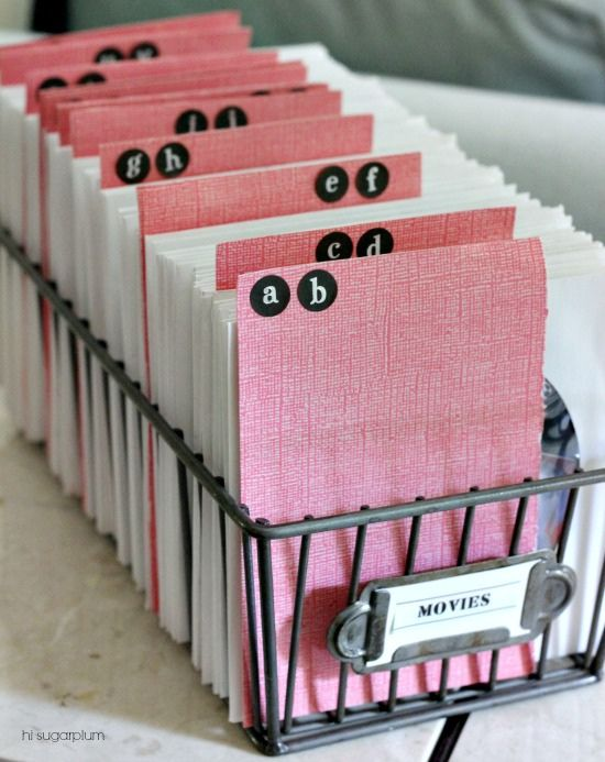 Get rid of the bulky cases and store CDs and DVDs in envelopes and file them.  {Hi Sugarplum | Organized DVDs & CDs}