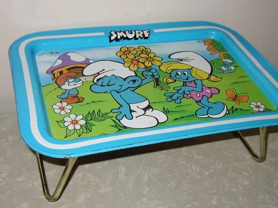 I had this tray for a long time.  I liked the idea of being served breakfast in bed, though my mother was never willing to indulge me.