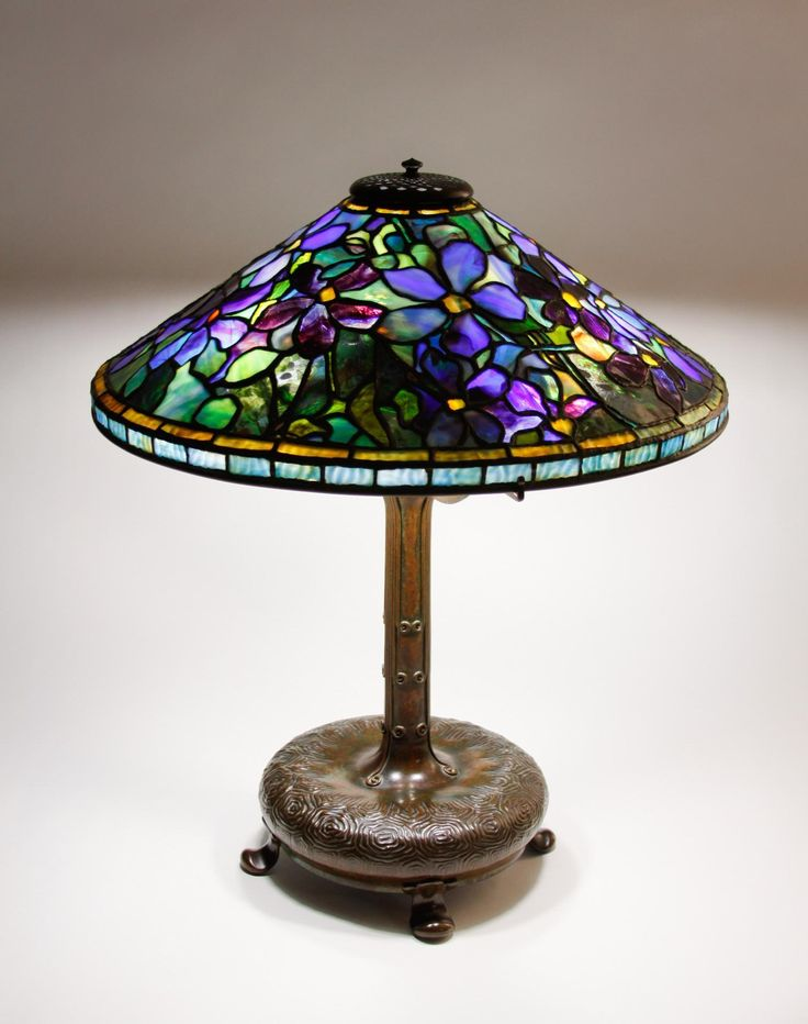 "Tiffany Studios, New York, Favrile Leaded Glass and Patinated Bronze ""Clematis"" Lamp."