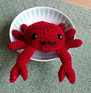 This is a amigurumi/stuffed animal that is in the shape of a Crab :) It is made by making to Hexagon motifs, 6 legs and 1 arms that are sewn together and stuffed. It is worked in the round/spiral. Originally a norwegian pattern on my blog, but made into an english version for download here on Ravelry.