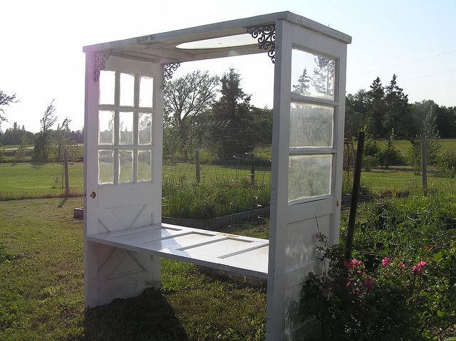 """Bench arbor made from four doors. I love this, but then thought about safety of this kind of glass outdoors, and thought """"maybe not for a few years?""""."""