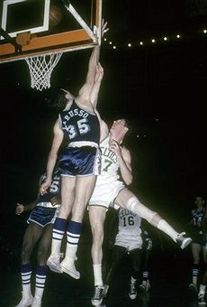 John Havlicek #17 of the Boston Celtics gets his shot over the out stretched arm of center Rudy LaRusso #35 of the Los Angeles Lakers circa 1965 during an NBA basketball game at the Boston Garden in Boston, Massachusetts. Havlicek played for the Celtics from 1962 - 78.