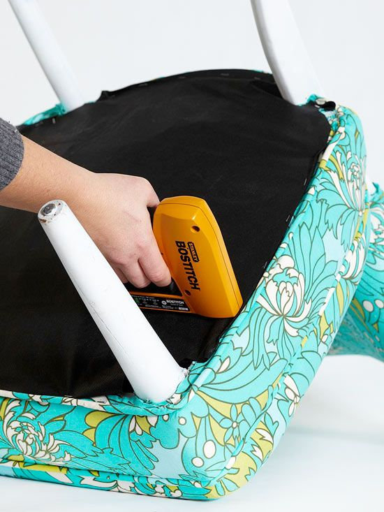 Cut a piece of black breathable fabric for the underside of the chair using the old piece as your guide. Flip chair upside down, and staple fabric to the underside to conceal any springs or webbing and act as a dust cover.