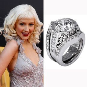 Stephen Webster designed Christina Aguilera's five-carat diamond and platinum ring, which combines princess cut diamonds and hand filigree detail.  See more photos of Christina Aguilera and Jordan Bratman's wedding.Photo: Flynet Pictures