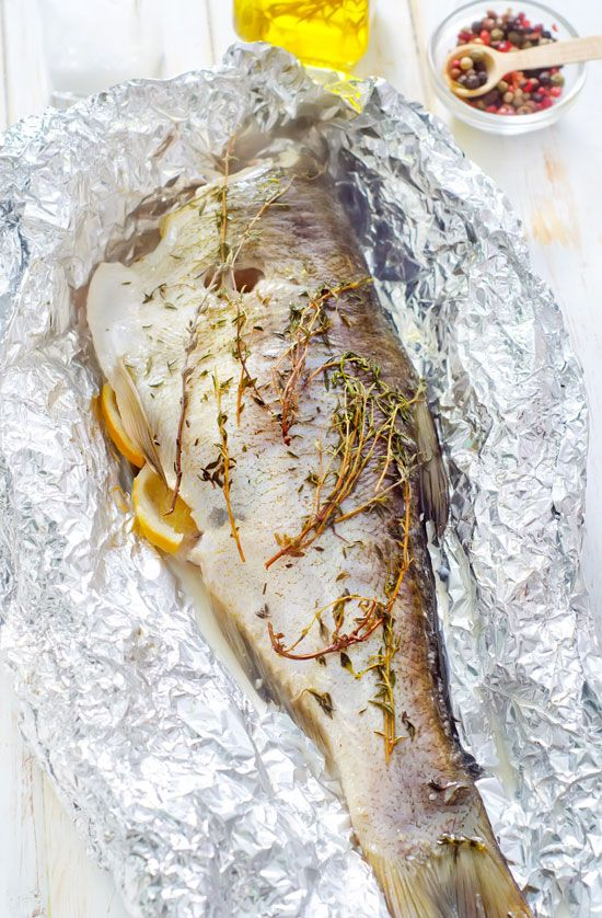 Baking Fish In Foil with a medley of aromatic ingredients creates a truly flavorful dish, and is a breeze to clean up.