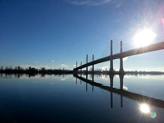 The sunny skies of Dec. 30 made for calm waters along the Fraser River and a beautiful clear sky as a backdrop for this picture of Golden Ears Bridge, taken by 14-year-old Chris Carter.