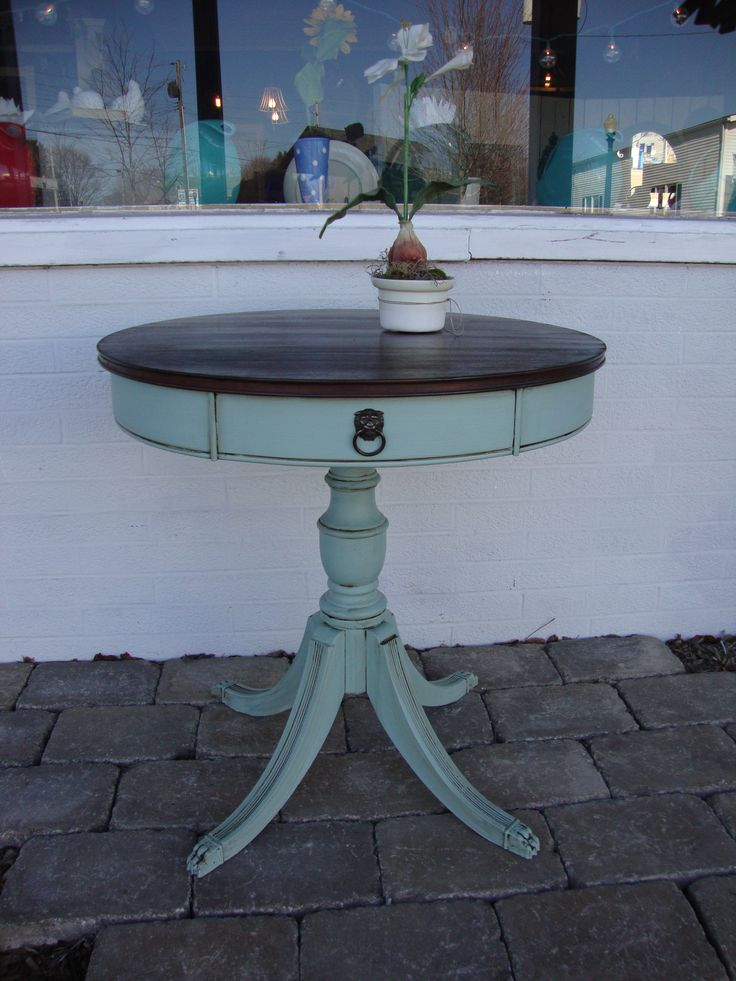 This Duncan Phyfe drum table was painted in Maison Blanche creme de menthe with the top stained in antique walnut.