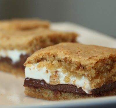Baked Smores Bars - Cookies, good. S'mores, good. S'mores cookies, GENIUS! The concept is simple, but the results are outstanding! They taste better than smores in my opinion. For those of you who prefer the chewy cookie to the crispy cookie, this is for you.