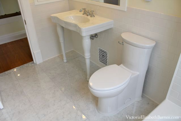 Concealed trapway toilet.  The skirted style is SO much nicer! We chose American Standard Tropic, I will never buy a regular toilet again!