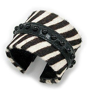 Zebra Print Leather Cuff with Onyx Crazy4Bling.com. $49.49. Diameter: 54 x 56 mm.. Width: 49 mm.. Product Type: Bracelet. Setting Type: Bond. Semi GemStones: Onyx. Material: Leather. Save 25% Off!