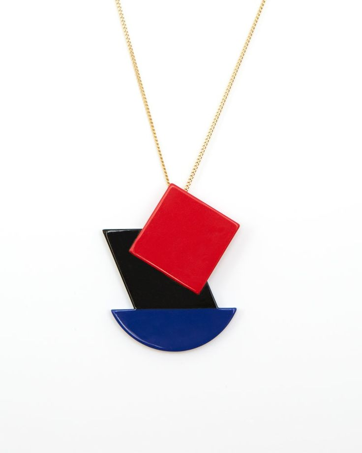 Kobro is a pendant highly influenced by the artistic Constructivism philosophy in red, black and blue. Mounted on a golden brass chain. Total...