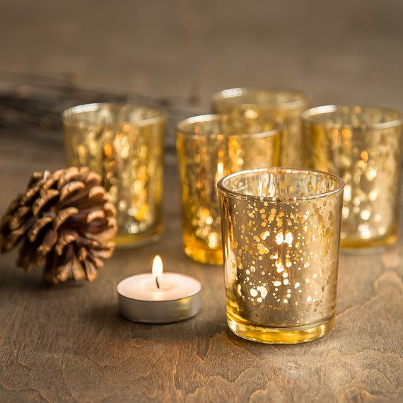 Gold tea light holders. A very glamorous tea light holder indeed and look great placed around centrepieces and table displays.