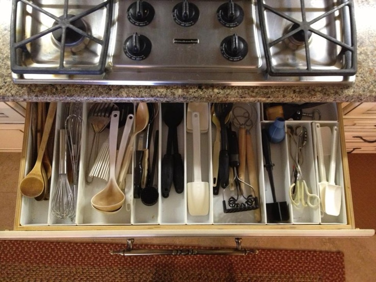 Shallow drawer underneath the cooktop for cooking utensils.