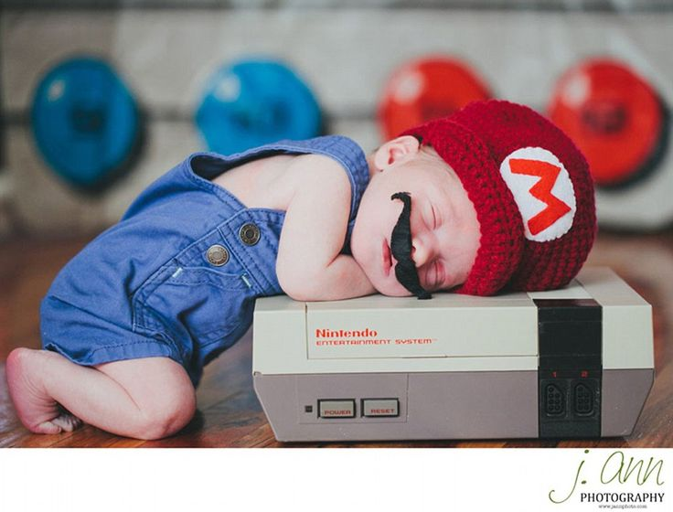 Another baby is dressed up as widely-recognisable Nintendo character Mario, complete with ...