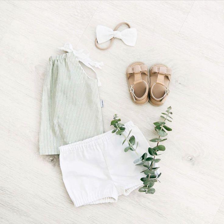 Baby girl flatlay featuring Sadie Baby clothing range & their Maggie summer sandals