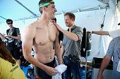 Prince Harry congratulates GB Armed Forces Team Captain David Wiseman in the competitor's tent at the swimming pool during the Invictus Games Orlando...