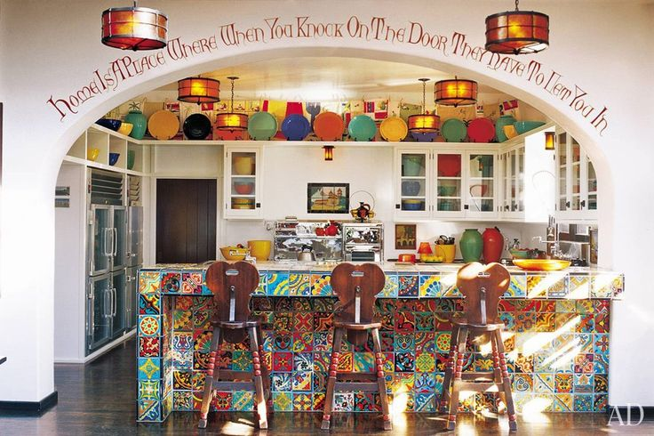 I adore this kitchen belonging to Diane Keaton..she collected the tiles at swap meets! A quote by Robert Frost frames the arch. I love this kitchen, it's just like her, fabulously colorful and unique!