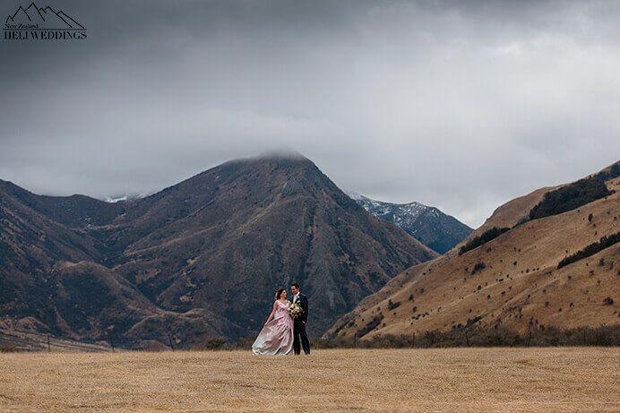 Bride wears pink wedding dress at Moke Lake, Queenstown, NZ